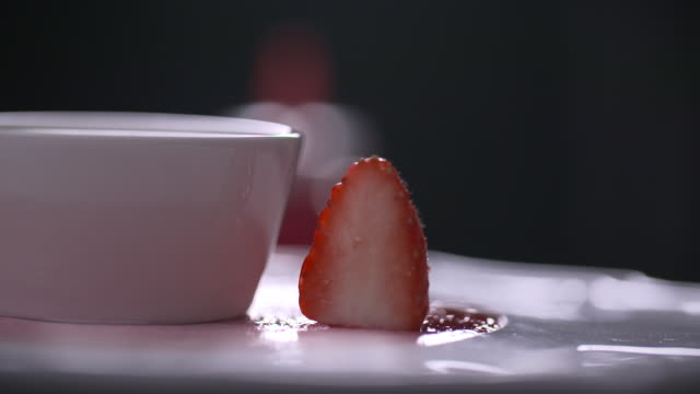 view of strawberry being put on rotating dessert plate - decorating stock videos & royalty-free footage