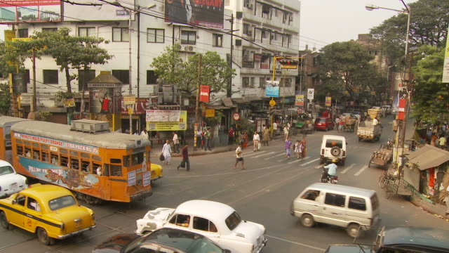 view of street in kolkata india - tram stock videos & royalty-free footage
