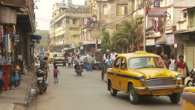 view of street in kolkata india - calcutta video stock e b–roll