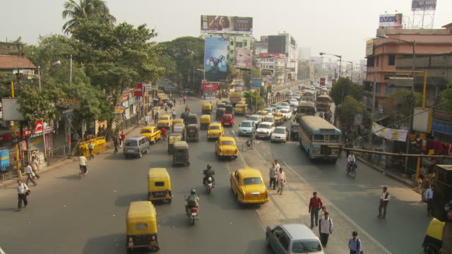 view of street in kolkata india - rickshaw stock videos and b-roll footage