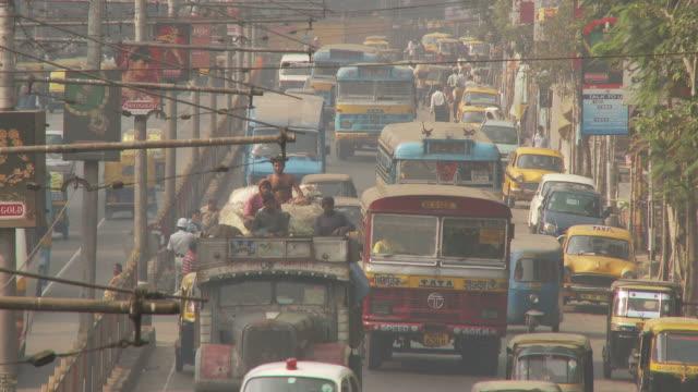 view of street in kolkata india - kolkata stock videos & royalty-free footage