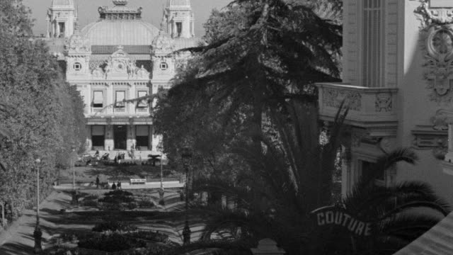 WS View of street in Monte Carlo and trees on both sides of street with big casino building in back side