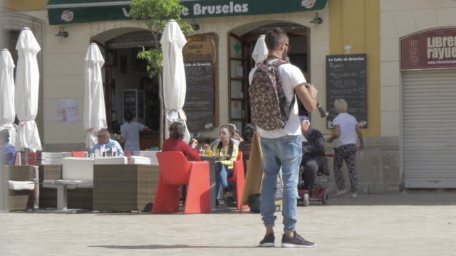 view of street musician in plaza de la merced, malaga, andalucia, spain, europe - performer stock videos & royalty-free footage