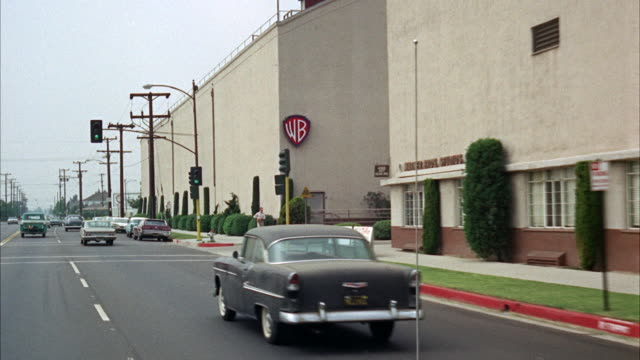 ms pov view of street near warner brothers studio - warner bros stock videos & royalty-free footage