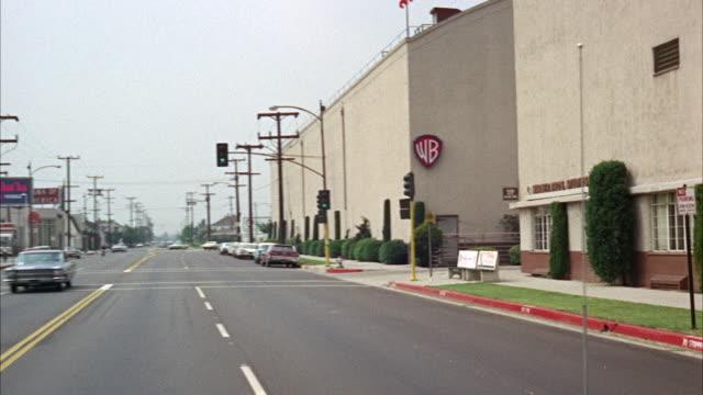 ms pov view of street near warner brothers studio - warner bros stock videos and b-roll footage