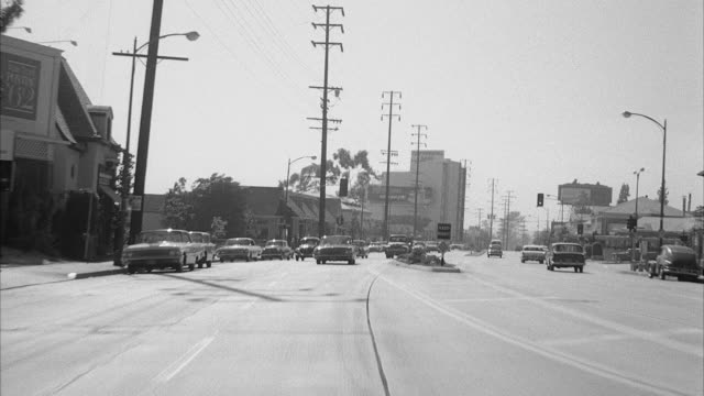 ms pov view of street on traffic/ hollywood, california, united states - sunset boulevard stock-videos und b-roll-filmmaterial