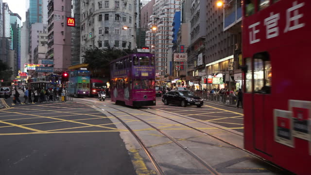 MS View of Street railcars and other traffic moving on street / Hong Kong, China