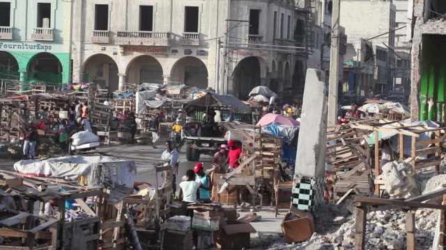 WS View of street scene vendors line up along street / Port-au-Prince, Haiti