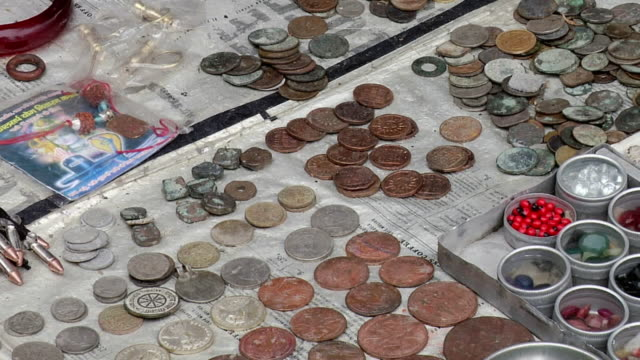CU ZO View of street shop of old coins and gems / Haridwar, Uttarakhand, India