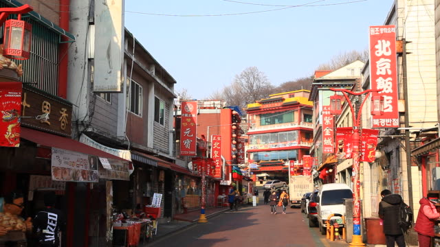 view of street with red store sign at incheon chinatown - store sign stock videos & royalty-free footage