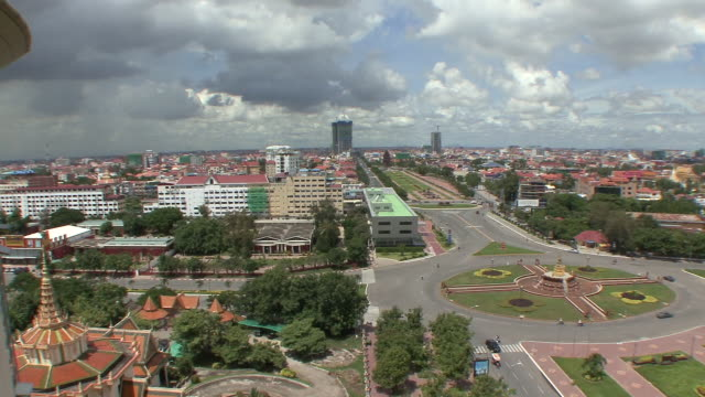 ws pan view of streets in city / phnom penh, cambodia - cambodia stock videos and b-roll footage