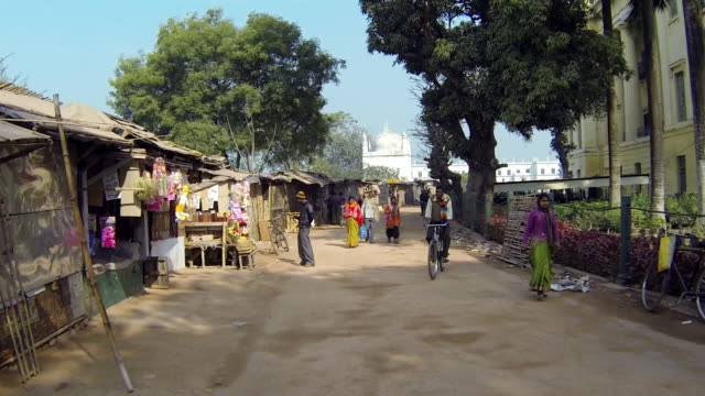 WS PAN View of Streets of people walking in small Indian Village / Murshidabad, West Bengal, India