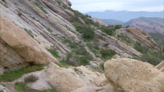 ms pan view of strewn boulder and rock / los angeles, california, united states - vasquez rocks stock videos and b-roll footage