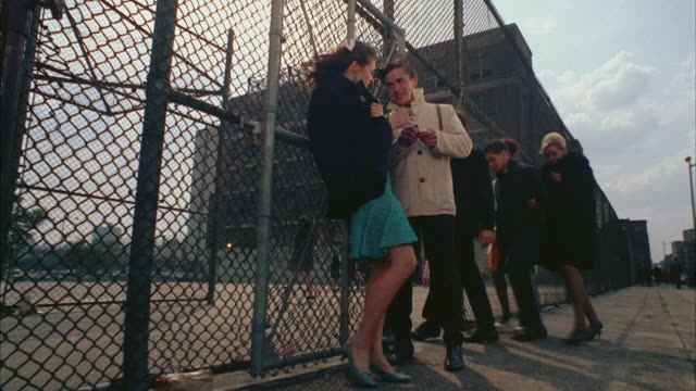 ws view of student smoking outside school building / new york city, new york, usa - 1966 stock videos & royalty-free footage