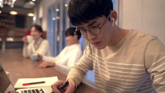 view of students studying and resting in cafe - korean ethnicity stock videos & royalty-free footage