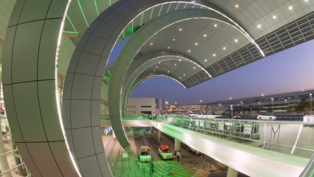 WS POV T/L View of Stylish modern architecture of terminal three of International Airport / Dubai,United Arab Emirates