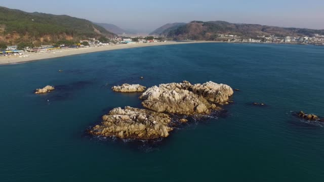 view of submerged royal tomb of king munmu(30th ruler of the silla kingdom) (korea historic place 158) at the bonggil beach in gyeongju, kyongsangbuk-do province - gyeongju stock videos & royalty-free footage