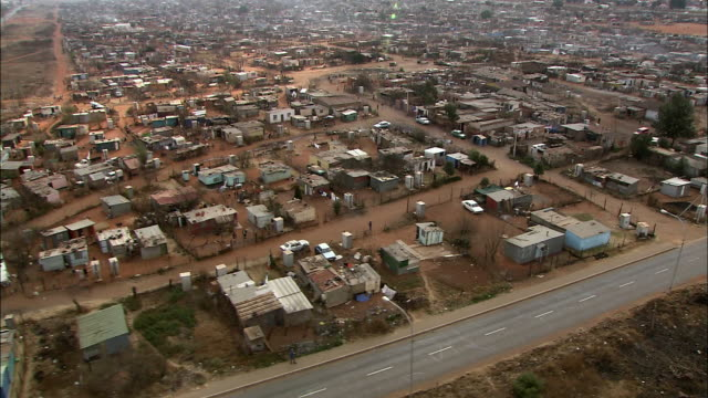 ws pov pan aerial view of suburban and slums of soweto / johannesburg, gauteng, south africa - soweto stock videos and b-roll footage