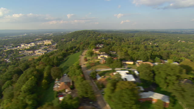 ws aerial view of suburban homes on tree covered ridge / chattanooga, tennessee, united states - tennessee stock videos & royalty-free footage