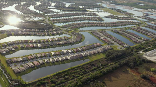 WS AERIAL POV View of suburban residential district / Everglades City, Florida, United States