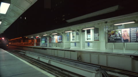 ms view of subway railroad train passing by subway station - underground station platform stock videos & royalty-free footage
