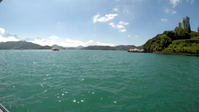 view of sun moon lake from tour-boat at nantou, taiwan - sun moon lake stock videos and b-roll footage