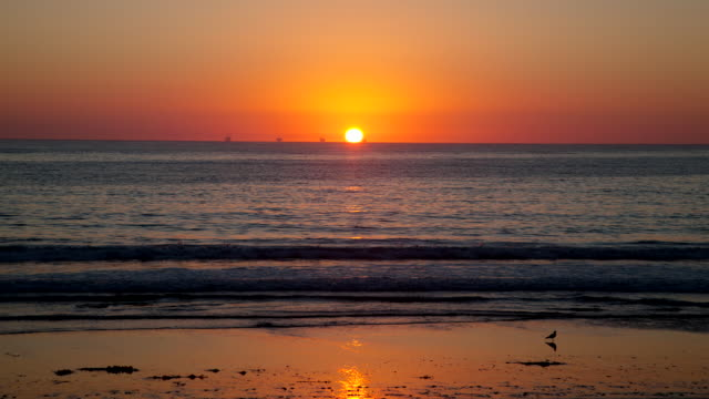 WS T/L View of sun sets in horizon behind Pacific / Mendocino, California, United States