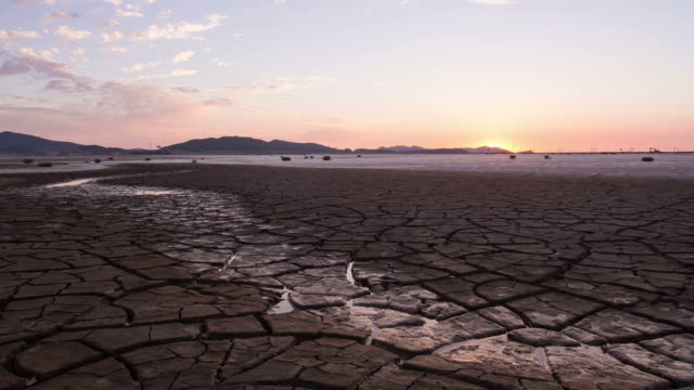 view of sunet and cracked ground at yeongjong-do - arid stock videos & royalty-free footage