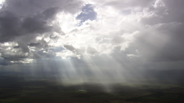 ws aerial view of sunrays coming out from clouds / brasilia, brazil - sunbeam stock videos and b-roll footage