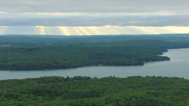 ws aerial view of sunrise and rain in over grand traverse bay / michigan, united state - michigan stock videos & royalty-free footage