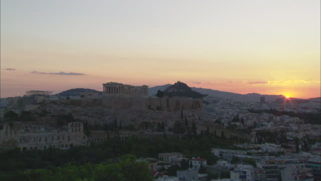 ws view of sunrise on athens city and acropolis of athens / athens, attica, greece - acropolis athens stock videos & royalty-free footage