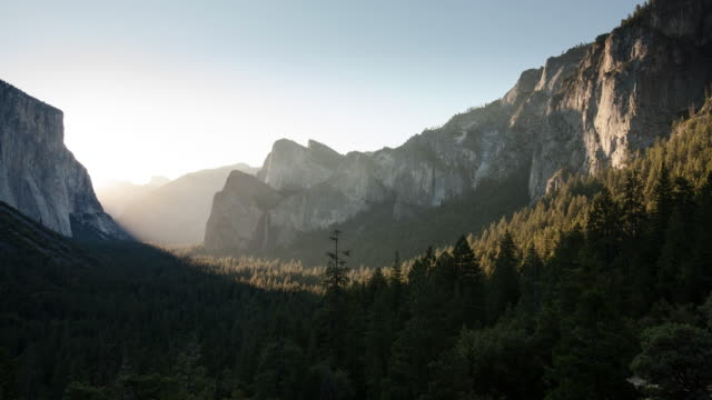 WS T/L View of sunrise on mountains / Yosemite, California, United States