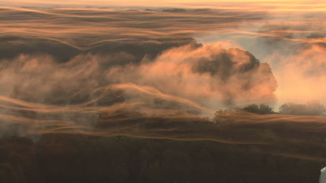 WS AERIAL ZO View of sunrise over Alabama River with stripes made of mist in red sky / Alabama, United States