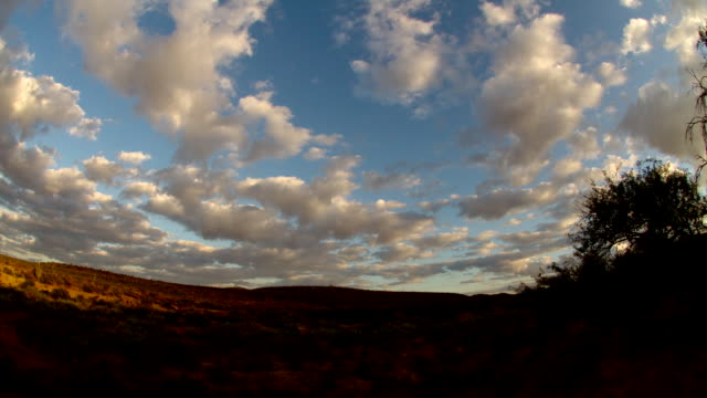 ws td t/l view of sunrise over desert with clouds flowing  / cascabel, arizona, united states - südwestliche bundesstaaten der usa stock-videos und b-roll-filmmaterial