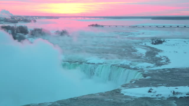 ws view of sunrise over horse shoe falls / niagara falls, ontario, canada - niagara falls stock videos and b-roll footage
