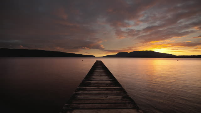 WS T/L View of sunrise over lake with jetty / Lake Tarawera, Rotorua, New Zealand