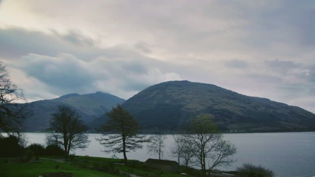 ws t/l view of sunrise over loch linnhe, trees with clouds / loch linnhe, scotland, united kingdom - 2k resolution stock videos and b-roll footage