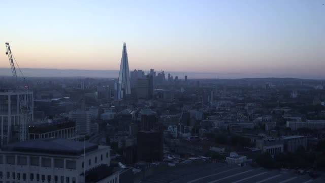 a view of sunrise over london from the london eye on the day of the summer solstice - sunrise dawn stock videos & royalty-free footage