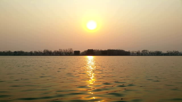 vidéos et rushes de a view of sunset at the kunming lake in the summer palace on march 4 2017 in beijing china - palais d'été pékin