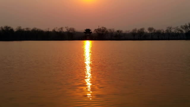 A view of sunset at the Kunming Lake in the Summer Palace on March 4 2017 in Beijing China