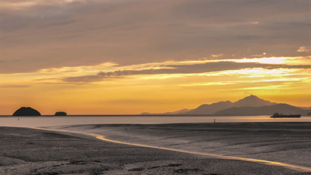 view of sunset at the mud flat in yeongjong-do area - mud flat stock videos and b-roll footage