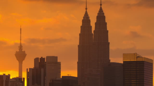 ms t/l view of sunset behind kl skyline / kuala lumpur, malaysia - kuala lumpur stock videos & royalty-free footage