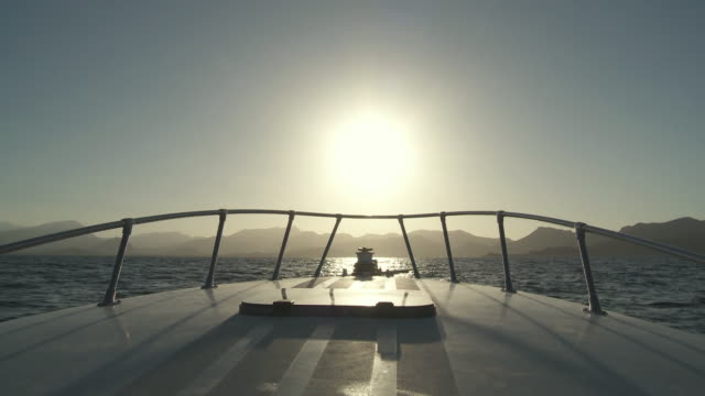 ms view of sunset from bow of speed boat / palma de majorque, majorque, spain - ship's bow stock videos and b-roll footage