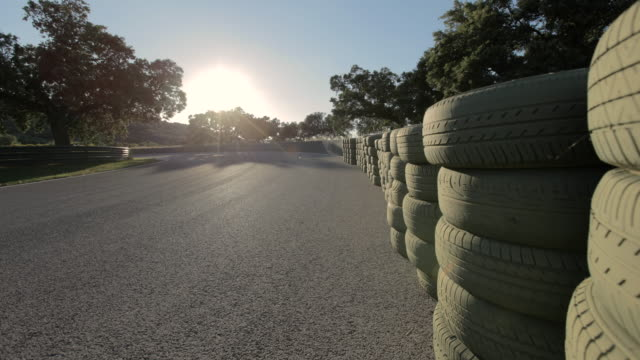 ws t/l view of sunset on ascari race track in spain at steep turn / ronda, malaga, spain  - abandoned stock videos & royalty-free footage