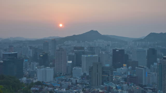 WS T/L View of sunset over cityscape of Myeongdong / Seoul, South Korea