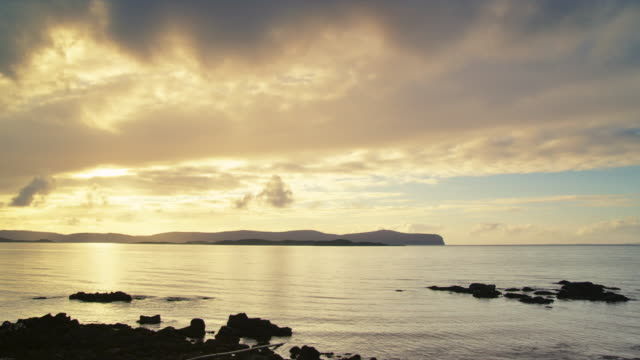 WS View of sunset over dunvegan head with clouds / Skye Island, Scotland, United Kingdom