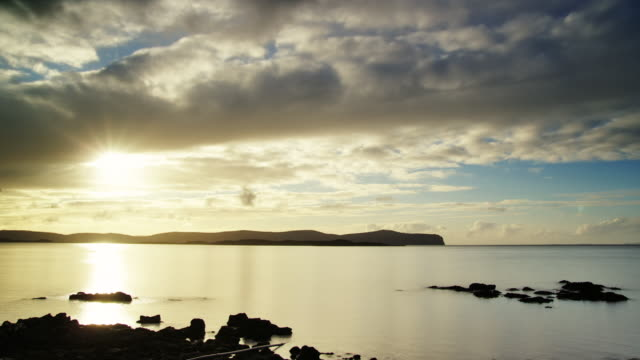 WS T/L View of sunset over dunvegan head with clouds / Skye Island, Scotland, United Kingdom