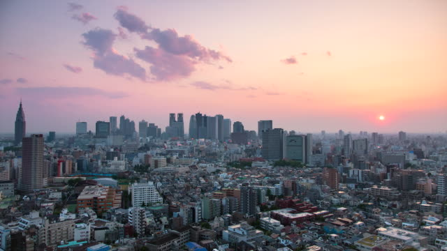 WS T/L View of sunset over Shinjuku business and shopping area / Tokyo, Japan