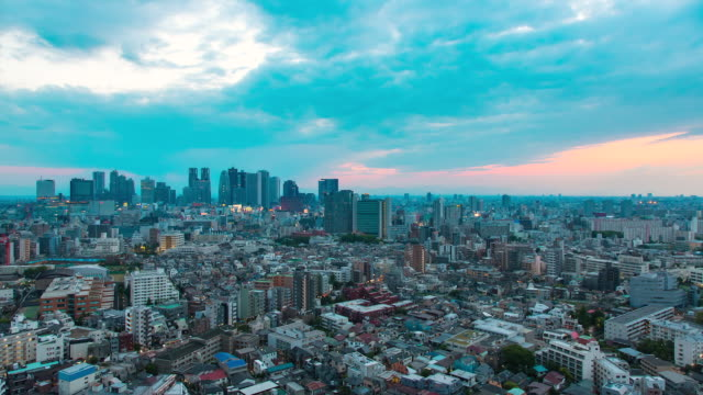 ws t/l view of sunset over shinjuku business and shopping area / tokyo, japan - japanese culture stock videos & royalty-free footage