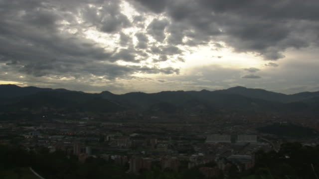 WS T/L View of sunset with city and clouds / Medellin, Colombia